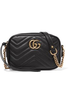 """Gucci's 'GG Marmont Camera' bag is decorated with burnished gold hardware that references an archival plaque from the '70s. Expertly crafted in Italy from black quilted leather, this compact style will look chic day or night, """"drawing admiring glances whatever the occasion,"""" says PORTER. Wear the chain-trimmed strap cross-body."""