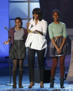 First lady Michelle Obama and daughters Sasha and Malia walk on stage during the Kids' Inaugural concert in Washington, Jan. Barack Obama, Malia Obama, Barak And Michelle Obama, Barrack And Michelle, Obama Daughter, First Daughter, Obama Family Pictures, Obama Sisters, Presidente Obama