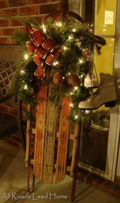 Holiday porch decor... vintage sled with lights and vintage skates - Love this: