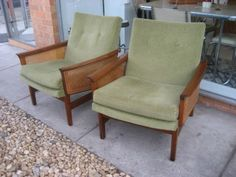 des. Fred Lowen 1964 mfr. Fler Furniture  Gorgeous pair of Flerline lounge chairs.  Blackwood frames, with rattan side detail. Fully upholstered buttoned backrests, with loose seat cushions, upholstered in a soft olive-green velveteen.  Very good vintage condition. Structurally sound, frames strong, internal springing remains supportive. Rattan intact and looking good.   An Australian mid century design classic - ready to use and enjoy...