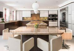 Dark Oak vaneer & White glass with granite worktops - See more at: http://www.bravermankitchens.co.uk/kitchens/modern-kitchens/#sthash.MkEBtNXI.dpuf #ModernKitchen #BrightKitchen #KitchenDesign #ModernDesign #DiningRoom #GraniteWorktops
