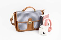 The camera bag not only holds your DSLR camera, but also serves as a messenger bag for your essentials, and leather exterior and nautical stripes deliver a fash Print Instagram Photos, How To Make Decorations, Nautical Stripes, Square Photos, Coastal Style, Cool Gadgets, Girly Girl, Gears, Diaper Bag