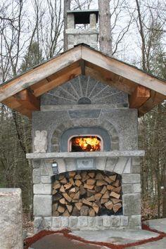 Outdoor Mugnaini wood-fired stone oven.