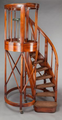 Furniture : English, AN EDWARDIAN MAHOGANY CIRCULAR STAIRCASE. Circa 1905. 106 incheshigh x 54 inches wide (269.2 x 137.2 cm). Property From...