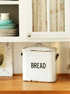 I love the shear curtain in the top of this cabinet..The feel is so shabby chic <3