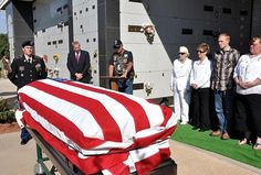 A veteran delivers the eulogy for a homeless Vietnam veteran who was buried last week with military honors through a charitable program. Three Gold Star Mothers look on in white. They go to the funerals to show support for the homeless veterans who normally die alone. Megan McCloskey/Stars and Stripes
