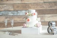 Buttercream-frosted wedding cake idea- three-tier wedding cake with fresh flowers {Mychelle LeVan Photography LLC}