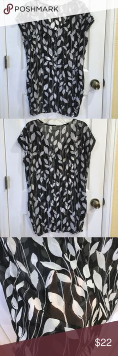 Brand new with tags, black and white cover up BRAND NEW with tags, black and white see through shirt. Would look adorable with tights. Can also be used as a cover up 💜 Anne Cole Swim Coverups
