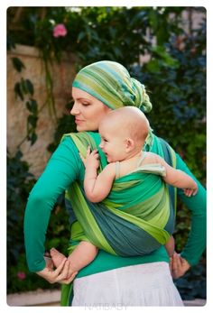 So if you are by yourself...how do you get the baby on your back!!!!! ????? I made homemade moby wraps that work perfect, but I am confused about the back carrying positions lol