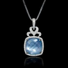 This beautiful 18k white gold pendant, features 1 mother of pearl over lapis…