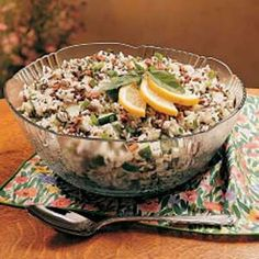 Lemon Rice Salad Recipe -This refreshing salad is wonderful served year-round. I have taken it to potluck suppers and made it for family barbecues, picnics and dinner parties. People seem to enjoy the combination of flavors in this dish. I like that it can be made ahead and still taste like I really fussed. -Margery Richmond, Lacombe, Alberta