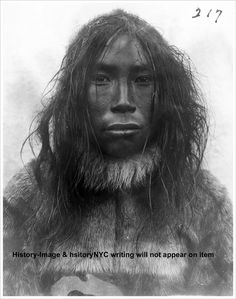 Inuit man, 1901-1902. This photo was taken during Cook's journey to Greenland as part of the Erik expedition.