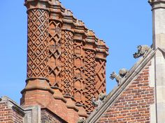 Love the chimneys and the gargoyles. By Kit Hope.