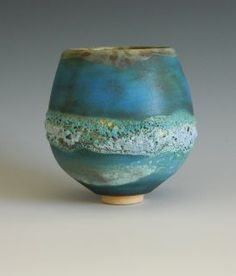 Jan Lewin-Cadogan. Technical: white stoneware clay. Various barium glazes. Various lava/crater glazes. Glossy deep blue or turquoise stone ware glazes. Fired to 1260 Celsius.