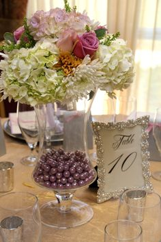 Short wedding reception centerpiece in lavender, rose and champagne colors with pearls table number frame