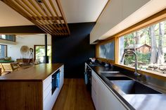 Modern Treetop Living in Sydney Houzz at a Glance Who lives here: Greg and Susan WIlliams, and their daughters (ages 9 and 10) Location: Freshwater, Australia Architect: Matt Elkan Architect Size: 2,153 square feet (200 square meters); 3 bedrooms, 3 bathrooms Year built: 2013 Photography by Simon Whitbread #kitchen