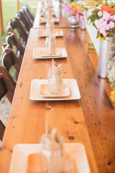 Cute Casual Wedding Table with Utensils Inside Mason Jars   See more of this #Whimsical Wedding on SMP: http://www.stylemepretty.com/2014/01/31/whimsical-connecticut-beach-wedding/ Photography: Catherine Rhodes