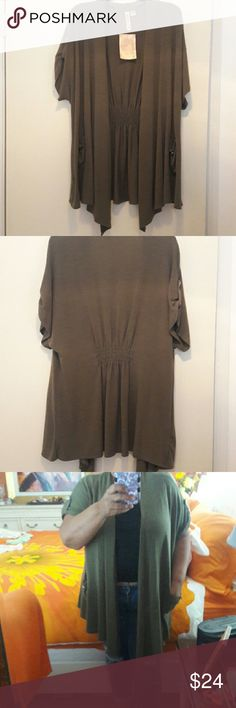 Olive Green Cardigan Eyeshadow open front shirt sleeve cardigan. Camo green/Olive with 2 front pockets and button tabs on sleeves. Elastic in waist in the back. 68% polyester/29% rayon/3% spandex machine wash. Waterfall design, size 2X. New, never worn. Eyeshadow Sweaters Cardigans