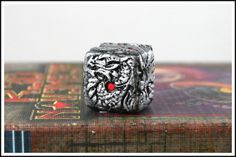 Dragon Dice by RobinRed on Etsy, available in silver, gold, and bone colors- great for rpg games!