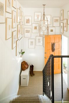 thin gold frames gallery wall, and oh the orange door (change the door to yellow and the frames to silver)