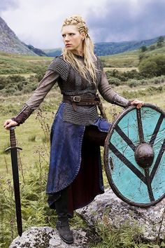 This is how to look badass without forfeiting all your femininity. Plus, that shield and hairdo are killer.