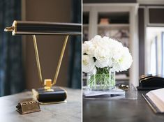 {The desk hosts a chic black and brass lamp along with a classic arrangement of white peonies
