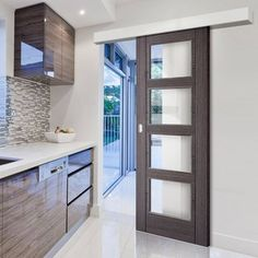 Bespoke Thruslide Surface Vancouver Ash Grey 4L Door with Clear Safety Glass - Prefinished Sliding Door and Track Kit - Lifestyle Image. #glazeddoor #slidingdoor