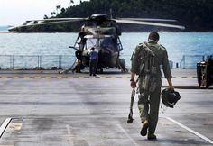 Leading Seaman Aircrew Roberto Waglers,808 Squadron, heads out to an MRH90 helicopter onboard HMAS Choules during Exercise Sea Lion 2013.The MRH90 is a multi use aircraft that replaced Navy's Sea King helicopters, and is set to take the place of the Army's Black Hawk helicopters.