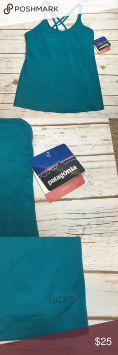 NWT teal Patagonia slim fit cordelisse tank This Patagonia Cordelisse tank top is super cute, it had a strappy criss cross back and a built in bra with removable padding. It's a slim fit top. Patagonia Tops Tank Tops