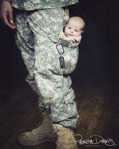 LOVE military baby photos. Too bad Rayne is too big for this now