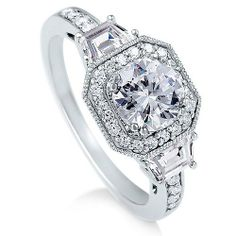 Sterling Silver Ring Round Cubic Zirconia CZ Ring 2.1 ct.tw - Nickel Free Engagement Wedding Ring: http://www.amazon.com/Sterling-Silver-Round-Cubic-Zirconia/dp/B0033IMB08/?tag=mdaz-20
