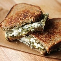 Grilled Pesto and Triple Cheese Sandwich - Who doesn't like pesto?!  Ok, my kid doesn't but I love it!  I want one.