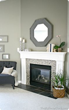 Paint color: Tornado Watch, Lowe's. Great sage green with blue-gray undertones. ~ Just love the fireplace look :)