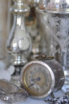Old alarm clock, old silver & mercury glass.