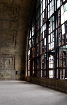 High ceilings and a whole wall of industrial windows. Love this although it's definitely way over the top. Would make a neat studio though. - Kim