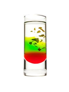 Christmas in a shot glass! Layered Christmas shooter recipe. 1/2 ounce sour apple schnapps 1/2 teaspoon grenadine 3/4 ounce cinnamon schnapps with gold flakes (preferably Gold Strike brand)