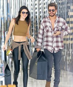 Reality stars Kendall Jenner and Scott Disick do some shopping together in Beverly Hills, California on December 23, 2014. Scott recently welcomed his third child into the world with Kourtney Kardashian, a baby boy named Reign Aston Disick.