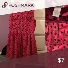Polka dot button down dress This definitely was worn quite a bit but it is not n pretty good condition. No stains or holes or anything and all the buttons are there. Might be a couple short little strings. It is a little on the shorter side. Looks great with a cardigan or black tights/fish-net like tights. Can be casual or dressed up. Delia's Dresses Mini