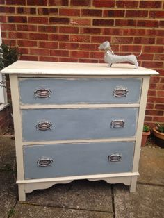 Hand painted chest of drawers. I used Grand Illusions Vintage Paints. The drawers have been 2 colour aged with No.3 Linen underneath and No.20 Fjord on top and distressed. Finished with the matte varnish.   www.facebook.com/daisybellefurniture  #handpainted #vintagefurniture #vintagepaint #upcycledfurniture #shabbychic #daisybellefurniture #paintedfurniture