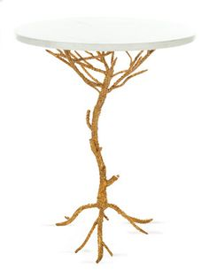 it's gold, it's twiglike, it's a coffee table, and therefore, is rightfully mine.    Carolyn Accent Table by Safavieh on Gilt Home