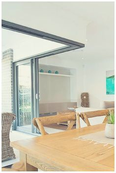 This 90° sliding stacker door opens up the indoor and outdoor living areas. Home & Wideline Sliding Stacking Doors give this beautiful dining room from ...