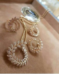 Gold Diamond set earrings pendant ring love