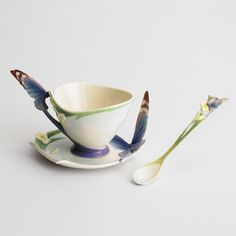 Butterfly design sculptured porcelain blue cup & saucer set, and spoon
