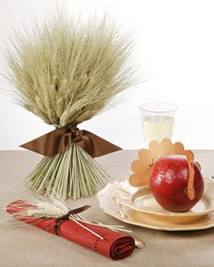 Wheat Sheaf Centerpiece and Napkin Ring: Have fun at the crafts store choosing ribbon in beautiful fall colors to make these easy, budget-friendly napkin rings and centerpiece. Use matching ribbon for everything or pick a few contrasting colors.