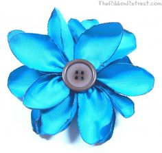 Burnt Petal Flower - {The Ribbon Retreat Blog}   instead of using ribbon and cutting it into petals try using silk petals.