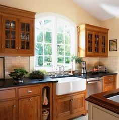 What Goes With Wood Cabinets?  Soapstone counters + buttery walls + a classic farmhouse sink + subway tile backsplash + cherry cabinets + that gorgeous window = charming kitchen.             (adsbygoogle = window.adsbygoogle || []).push({});      Source  by  nvazquez17  http://centophobe.com/what-goes-with-wood-cabinets/