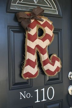 DIY Burlap Door Hanger Tutorial...Materials Needed: Burlap, Hot Glue/Glue gun, Paint, Stuffing, Wire, and Ribbon.  Click on photo for full tutorial.
