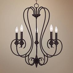 Illuminate your home with this timeless chandelier featuring a handsome bronze finish and an elegant curved design.