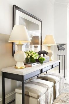 Very pretty foyer console set up - bench/ottomans underneath, 2 lamps with mirror
