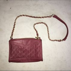 Never used purse Quilted leather shoulder bag from Charming Charlie's. Gorgeous deep red color. Gold link strap. Never used!! Brand new!! Price firm unless bundled. Charming Charlie Bags Crossbody Bags